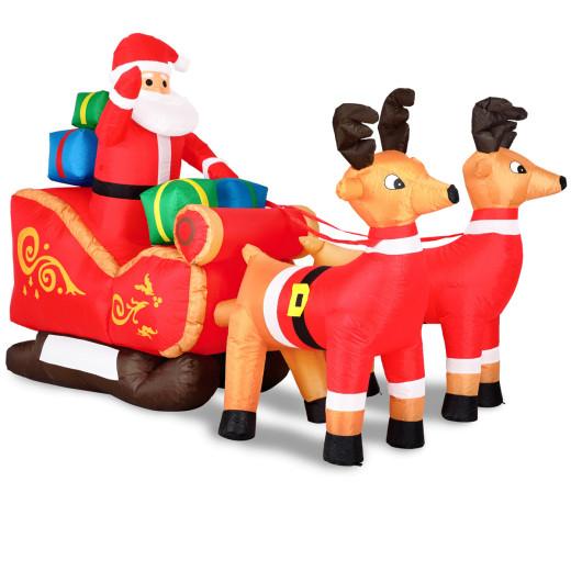 Père Noël gonflable avec traîneau et rennes